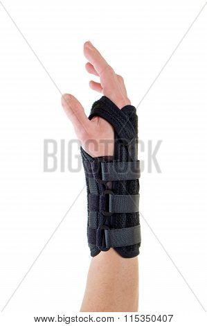 Person Wearing Supportive Brace On Wrist