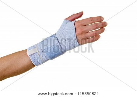 Person Wearing Supportive Hand And Wrist Brace