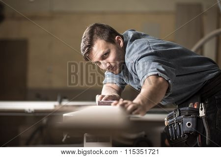 Wood Expert Checking Board's Quality