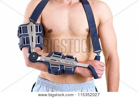 Shirtless Man With Arm In Articulated Sling