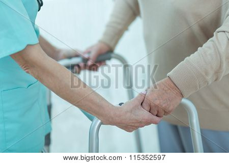 Nurse Helping Disabled Elderly Lady
