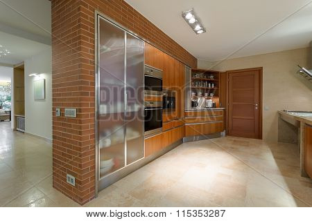 Horizontal photo of grand and luxurious kitchen in a residence poster