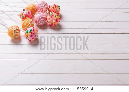 Cake Pops On White Wooden Background.