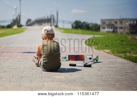 The Boy Sits A Back, Fell From The Scooter In Open Air