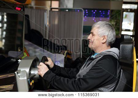 Man Playing Arcade Game Machine