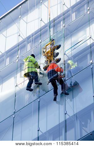 Repair On A Building Glass Front
