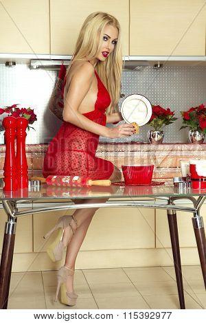 Sexy Blonde Girl In Kitchen.