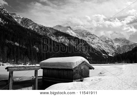lonely cottage on a lake in winter