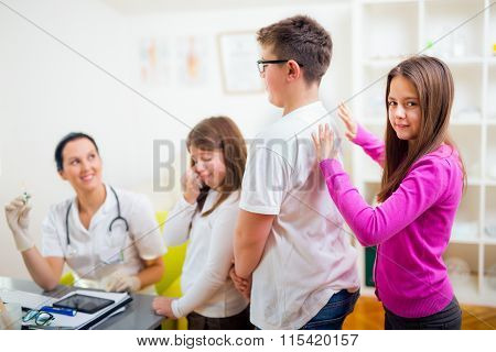 Female doctor and patient teenagers .Vaccination. Medical examination.