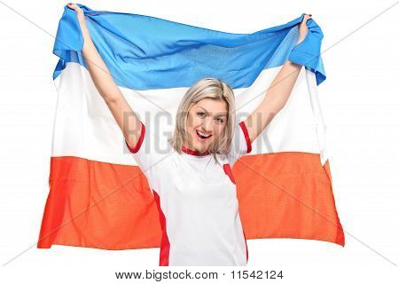 A Female Sport Fan Smiling With Holland's Flag