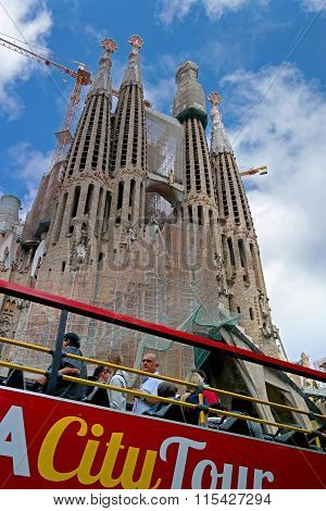 Barcelona, Spain - May 17, 2014: Cathedral Of The Sagrada Familia Inspect Passengers Tour Bus