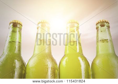 Four Dewy Bottles With Fresh Beer