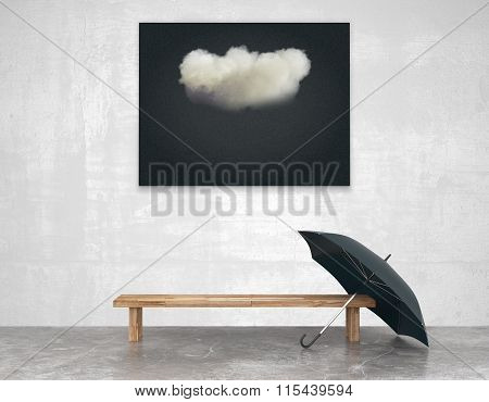 Interior Art With A Bench And A Black Picture Of A Cloud And Umbrella
