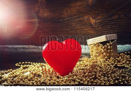 Heart, Gift And Flares On Wooden Background.
