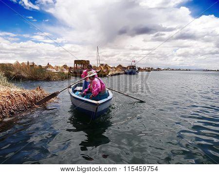 Two Women Navigating Lake Titicaca