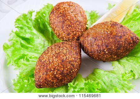 Icli kofta. Meatballs with bulgur