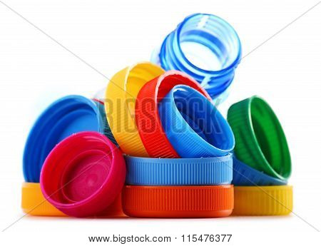 Composition With Plastic Bottles And Caps Isolated On White