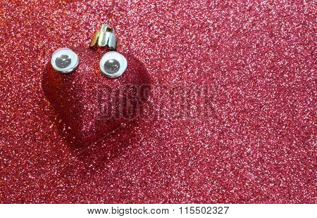 Lone Heart With Big Sad Languid Eyes On  Shiny Red Background