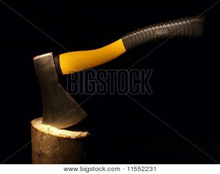 Hatchet Sticking Out Of A Log