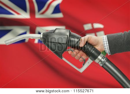 Fuel Pump Nozzle In Hand With Canadian Provinces Flags On Background - Manitoba