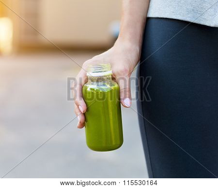Woman Drinking Vegetable Smoothie After Fitness Running Workout On Summer Day