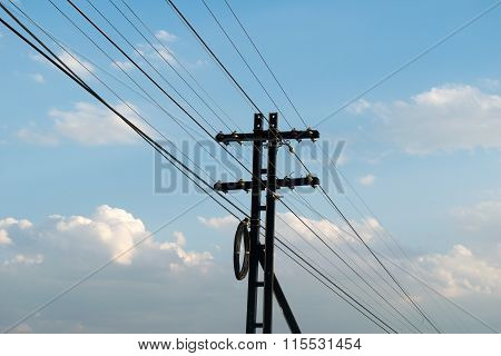 Electricity Post And Cable Alongside The Railway