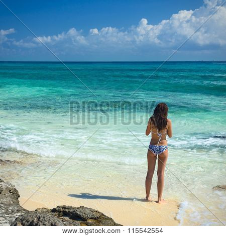 Beautiful Girl In A Swimsuit On The Sea. Woman With A Beautiful Figure In Swimsuit On The Tropical B