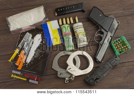 Sales of drugs. International crime, drug trafficking. Drugs and money on a wooden table