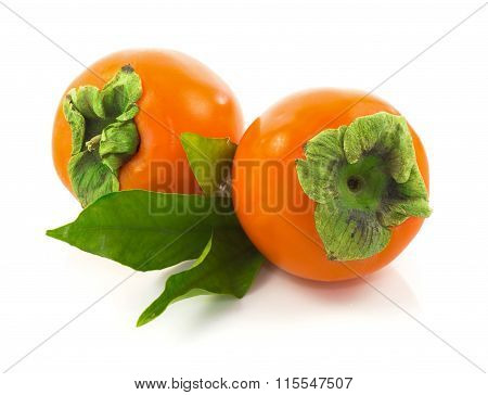 Ripe Whole Persimmons With Leaves