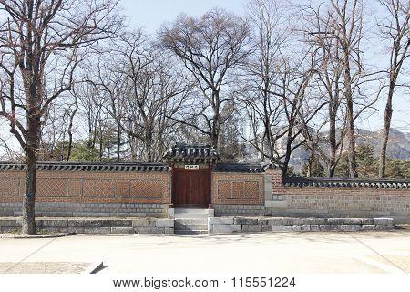 Gyeongbok Palace Brick Wall And Branch Dry Tree Garden Historic  In Korea