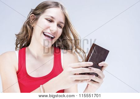 Dental Concepts And Ideas. Caucasian Female Teenager With Teeth Brackets Chatting By Cellphone. Happ
