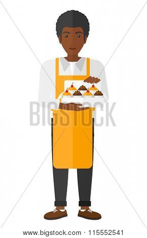 Baker holding box of cakes.