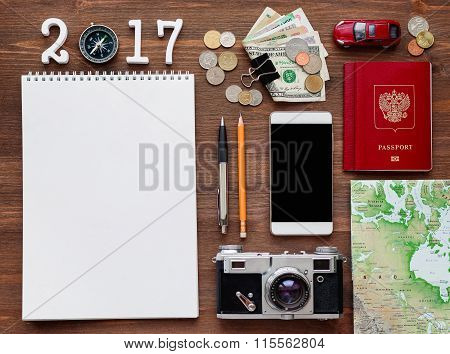 Travel Background 2017 Year. Different Things You Need For Journey - Notepad, Smartphone, Passport.