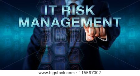 Consultant pushing IT RISK MANAGEMENT on a touch screen interface. Business metaphor and technology concept for a systematic approach to risk identification and management of information technology. poster