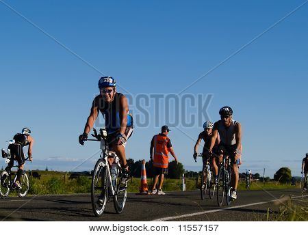 Cyclists approach a turnaround in ironman event.