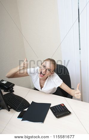 Business Woman Celebrating Victory At The Laptop Computer With Thump Up.