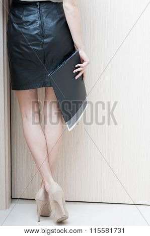 Rear View Of Female Long Legs  Shod In Beige  Shoes With High Heels.