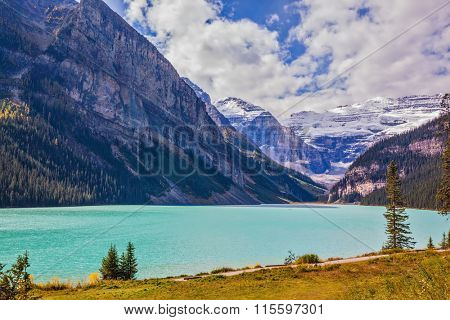 Magnificent Lake Louise is surrounded by mountain and glaciers. Rocky Mountains, Canada, Banff National Park. Great sunny day