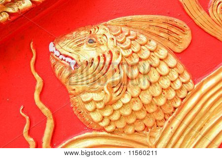 The gold fish wall sculptures of church Lampang Luang temple poster