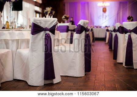 Elegant And Stylish Purple Color Wedding Reception At Luxury Restaurant: Tables, Flowers And Chairs