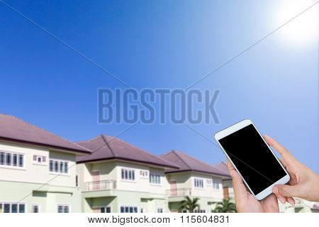 Woman Hand Hold And Touch Screen Smart Phone, New Home, New House
