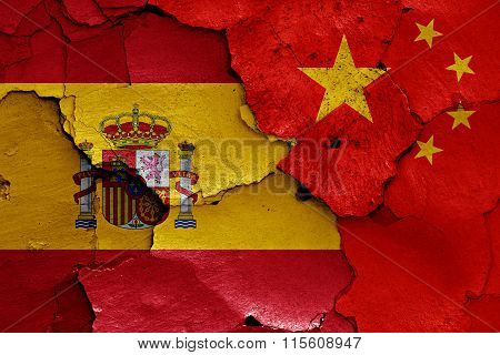 Flags Of Spain And China Painted On Cracked Wall