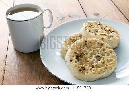 Tea And Crumpets On Wooden Table
