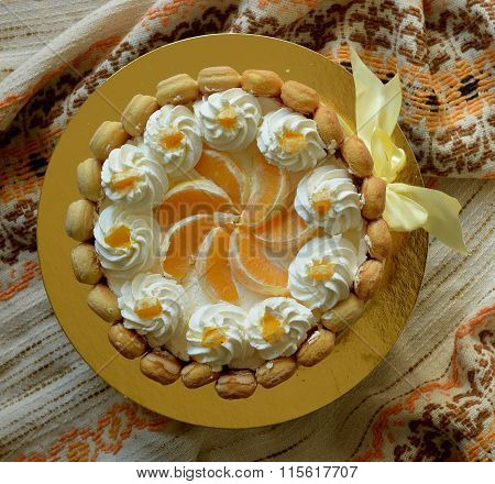 Pound cake charlotte with ladyfingers, oranges and whipped cream