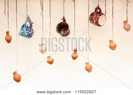 Cups And Clay Pots Hanging On The Ropes, The Design And Interior