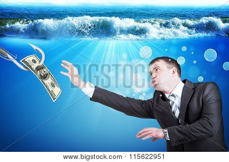 Businessman with inflated cheeks under water with hook and dollars poster