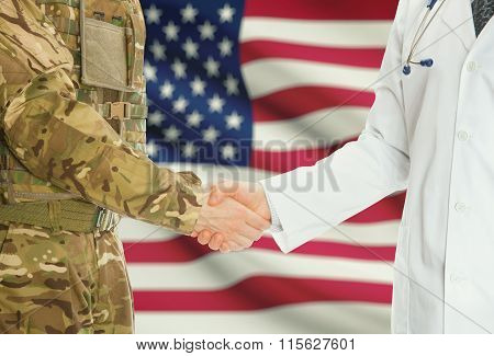 Military Man In Uniform And Doctor Shaking Hands With National Flag On Background - United States