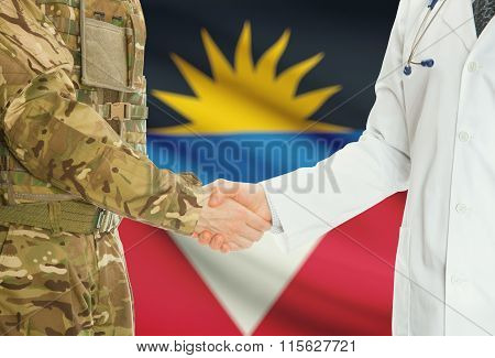 Military Man In Uniform And Doctor Shaking Hands With National Flag On Background - Antigua And Barb