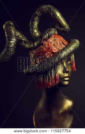 poster of Painted mannequin Girl with metal headwear on black background