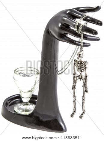 The composition of a glass, hand and hung the skeleton